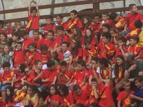 Children from each contrada in the race singing their respective fight songs